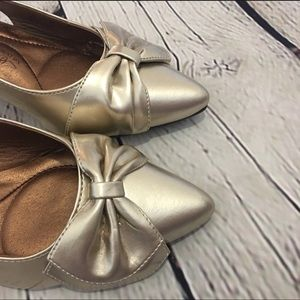 Gold sling backs with a bow